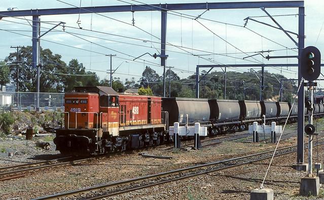 Empty Coke train. (scan)