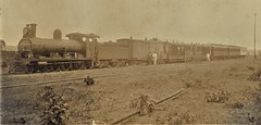 Africa Railways - Angola - Caminho de Ferro de Benguela (Benguela Railway) - CFB 4-6-0 steam locomotive and passenger train at Nova Lisboa (Huambo) (Neilson Locomotive Works, Glasgow 5144 / 1898)