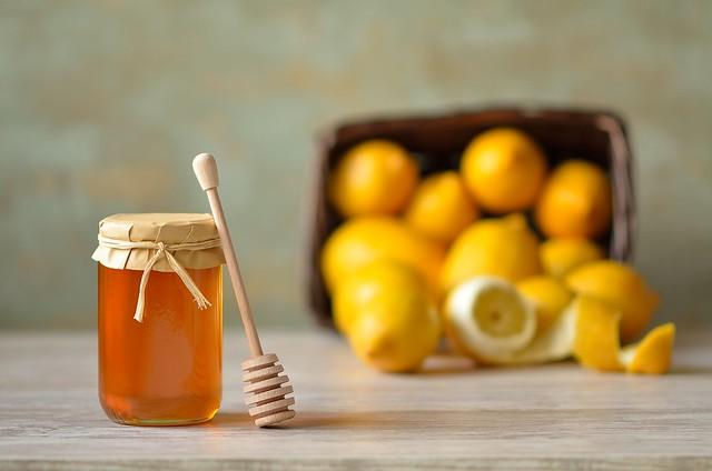 Still life with sweet honey over sour lemons