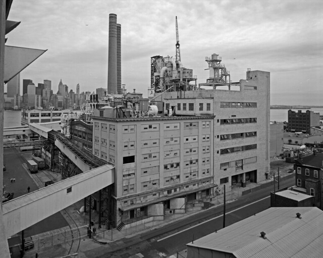 The 19th century Colgate plant near the Hudson River on a cloudy, moody and rainy day. Generations of people worked here making soap and toothpaste. Not a trace of it exists now. Manhattan and the World Trade Center at left. Jersey City. Sept 1984