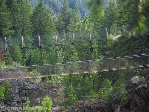 The two swinging bridges: old (top) and new over the Kootenai River, Cabinet Mountains, Montana
