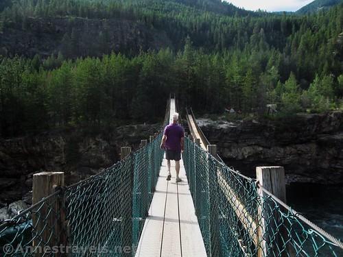 Crossing the Kootenai Swinging Bridge, Cabinet Mountains, Montana