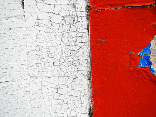 white cracked paint plus red