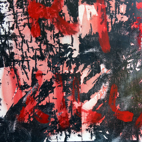 red, white and black graffiti on torn posters abstract