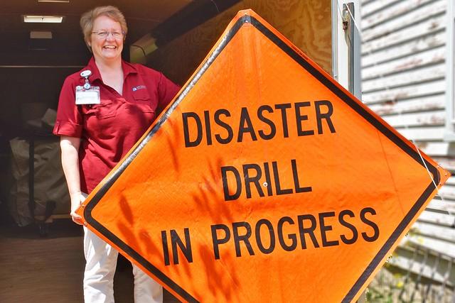 Barbara MacPike holding a sign