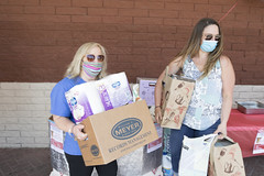 ShopRite Community Liaison MaryLou Grendziszewski and State Rep. Stephanie Cummings bring collected donations to GWIM.  Rep. Cummings hosted the food drive to support GWIM's food pantry.