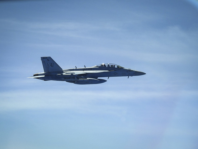 E/A-18G Growler with a B-52H Stratofortress over Sea of Japan while conducting a Bomber Task Force mission