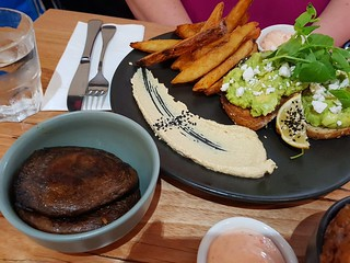 Acocado Toast with sides of Mushrooms and Handcut Chips at The Green Edge
