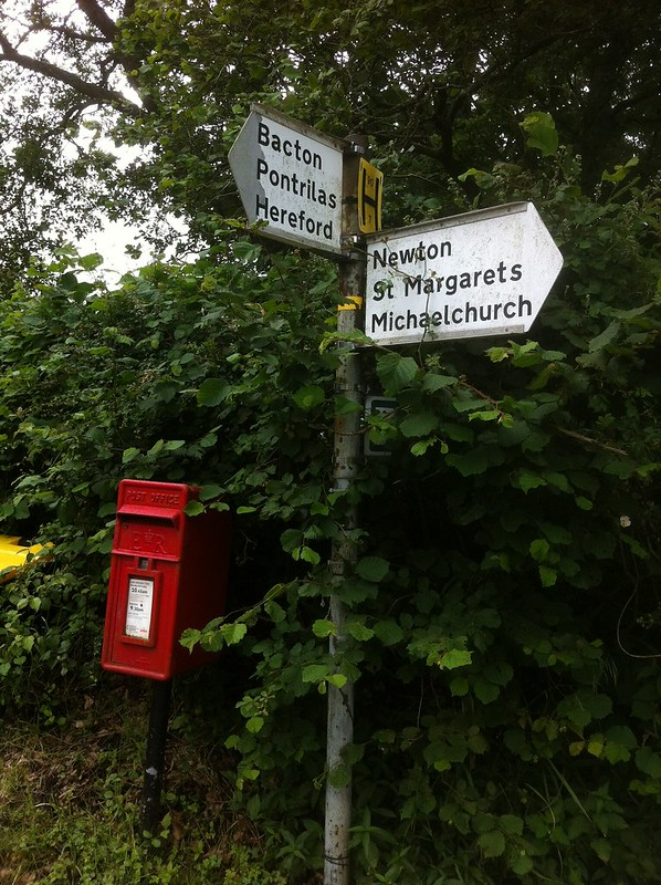 "Signposts and post box at the Tremorithic Road / ""Bacton Road"" T junction"