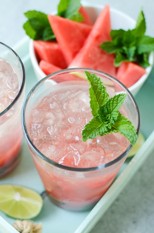 Watermelon Mojitos - fresh mint, watermelon, and limes muddled together and topped with rum and sparking water. One of my favorite summer drinks!