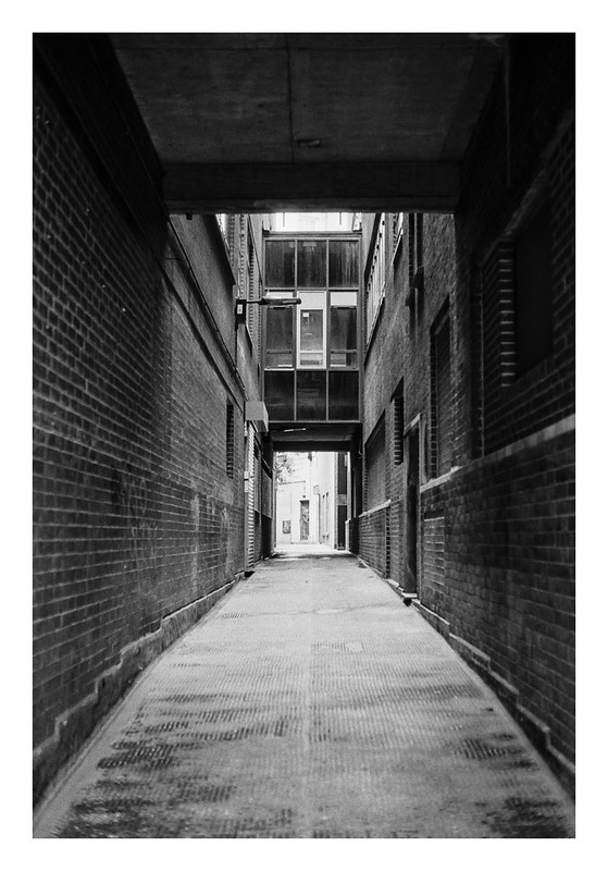Down empty alleyways