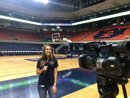 Delaney Baro reporting on a basketball court.