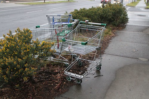 Tangle of abandoned shopping trolleys, having had their coin deposit removed