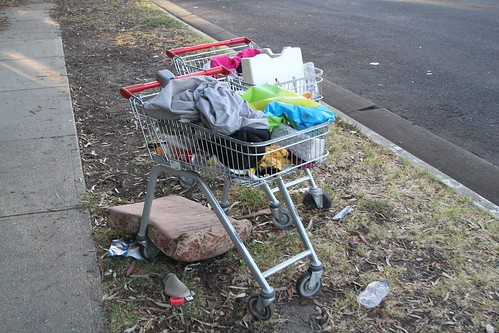 Shopping trolleys filled with rubbish then abandoned on the nature strip