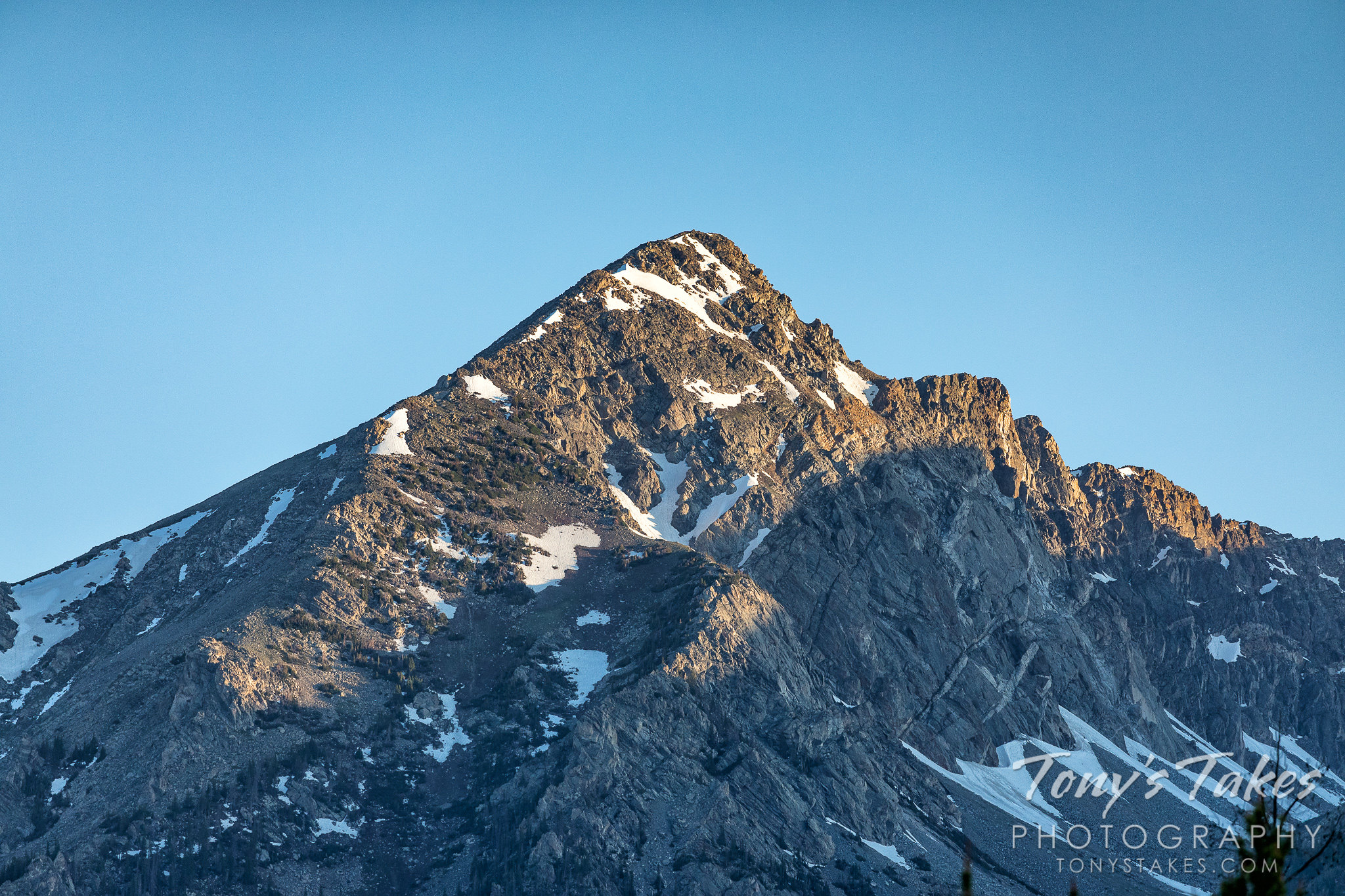 The day's first light hits Bowen Mountain in Rocky Mountain National Park. (© Tony's Takes)