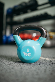 Focused picture of kettlebell in gym with blurry background | by shixart1985