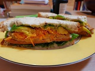 Tofurky Ham, Miyoko's Cheese, and salad sandwich