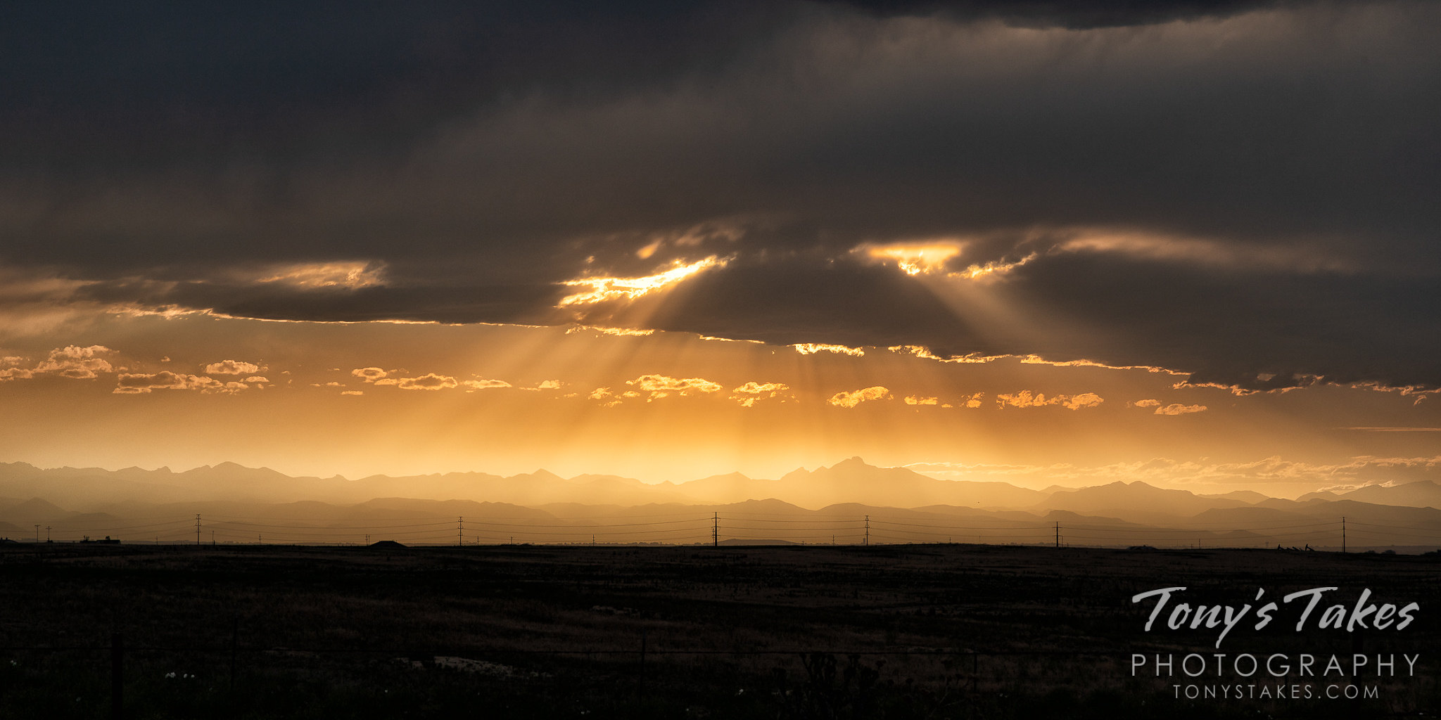 Haze from wildfires create a beautiful sunset on the Colorado Front Range. (© Tony's Takes)