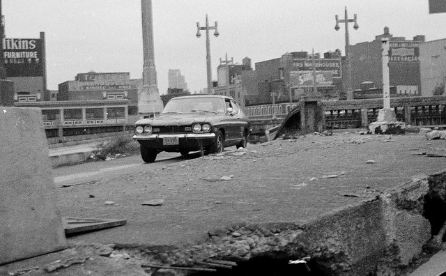 A lone 1971 Ford Capri navigates the decrepit old West Side Highway. With absolutely no maintenance since its construction in the 1920s, it was inevitable that a collapse took place in November 1973. April 1973. New York.