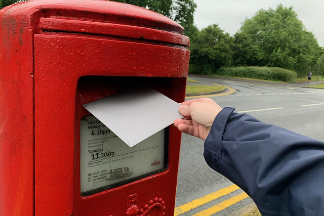 Posting a card in the rain