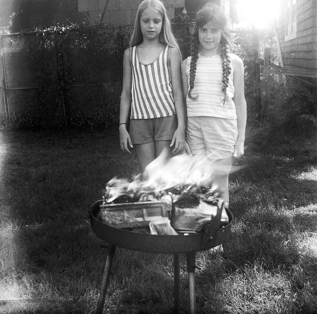 A rare Druid ritual and YOU are there to witness it! Two girls pay homage to the Deities Of Fire by toasting an old Tonka dump truck in my dad's barbecue. Milford Connecticut. July 1973