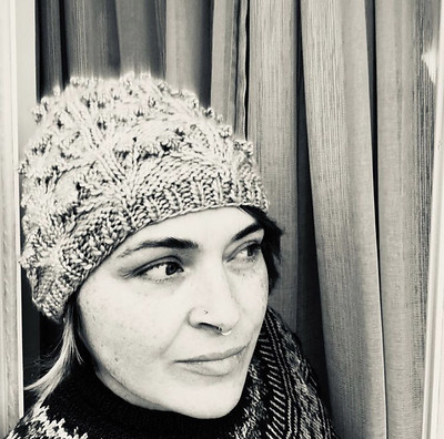 Diane (@boujeeknits) knit two Orchids and Fairy Lights hats Tiny Owl Knits using Malabrigo Worsted