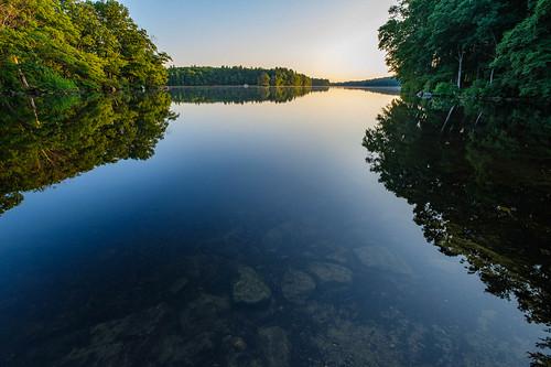 handheld lake landscape reflection rocks sky statepark summer sunrise trees ashland massachusetts unitedstatesofamerica
