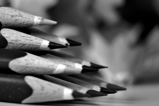 Ten colour pencils in black and white