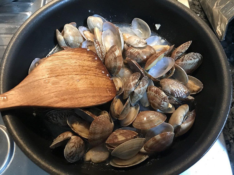 Add the clams and the sake