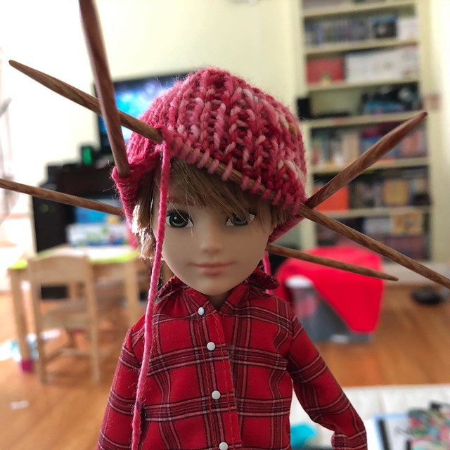 Kiddo asked me to make a hat for her doll out of the leftovers from the hat I made for her.