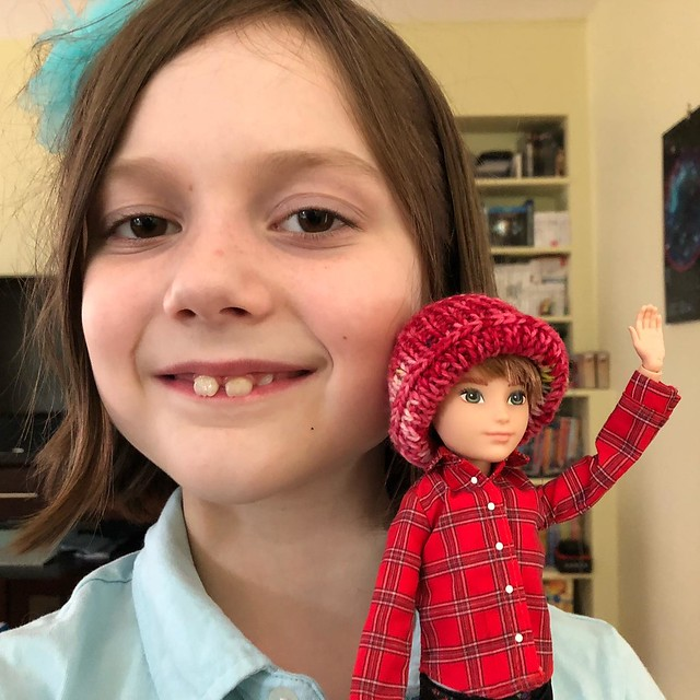 Happy kiddo with her be-hatted doll.