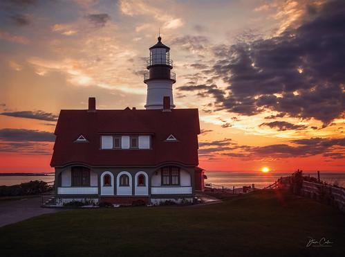 lighthouse portland maine sunrise color atlantic ocean water sea glow