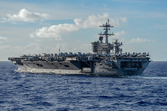 In this file photo, USS Theodore Roosevelt (CVN 71) sails in the Philippine Sea, June 23, during dual carrier operations with USS Nimitz (CVN 68). (U.S. Navy/MC3 Sean Lynch)