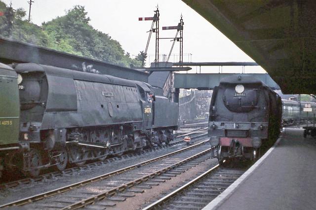 34070 watching 34081 arriving at Barnstaple Jnc in 1962