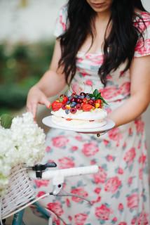 Glamour girl holding fruit cake closeup.