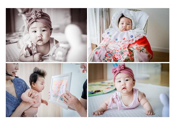 自宅で家族写真 ピンクのヘッドバンド 産着をかけた姿 赤ちゃん