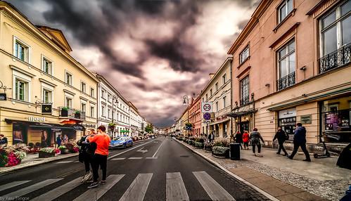 Life on streets of Warsaw, looking south on Nowy Świat from Swietokzjskain, Poland.  377-Edita
