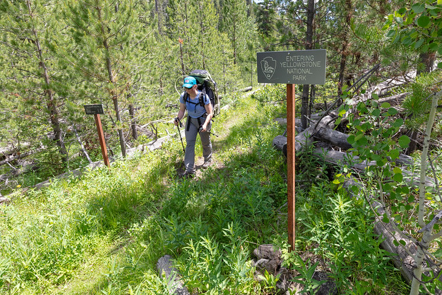 Backpacker crossing the Absaroka Beartooth Wilderness boundary