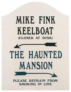 Mike Fink Keelboat & Haunted Mansion sign