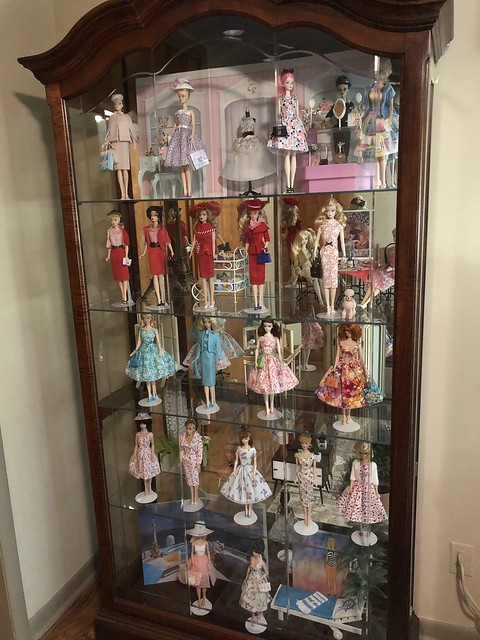 Doll displays and storage