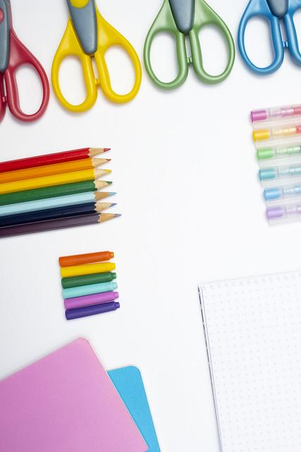 School supplies in rainbow colours, portrait format