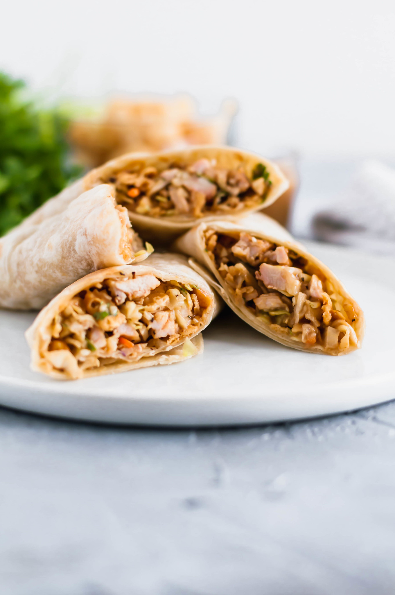 These Thai Chicken Wraps are sure to become a new summer favorite. Light, simple to make and totally addictive. Homemade peanut sauce adds so much flavor.