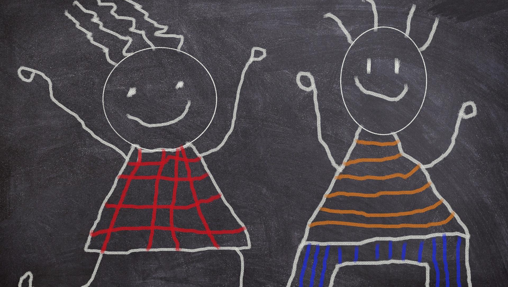 cartoon drawings of child figures on a blackboard