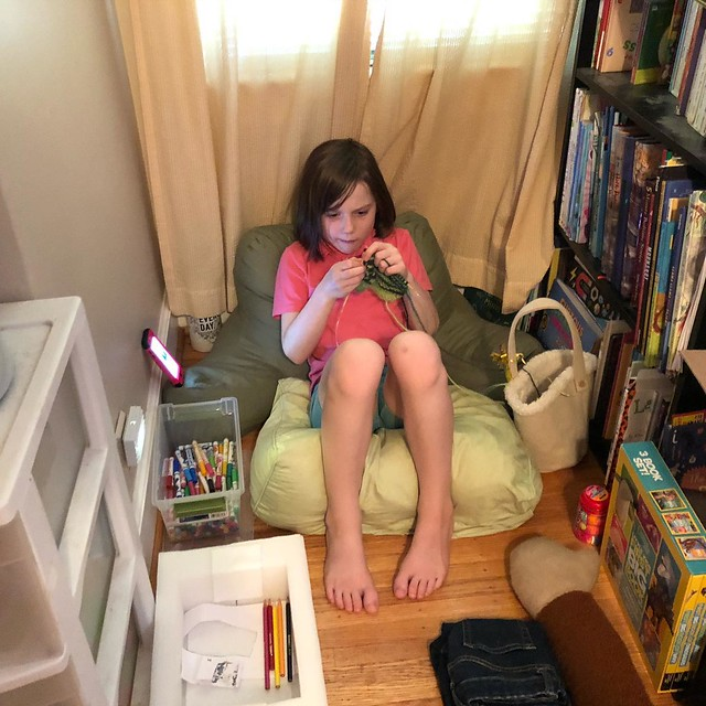 """Sitting in her """"nook"""", knitting while listening to a podcast. My heart!!"""