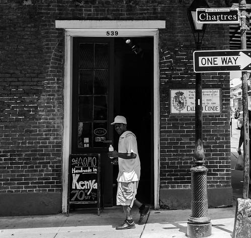 nola neworleans louisiana frenchquarter urban old blues gonbangaloo downtown people passerby signs bricks monochrome blackandwhite streetphotography street rabican7 fanikaranikola hww happywindowwednesday window