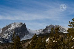 Hallett Peak and Flattop Mountain topped with snow.