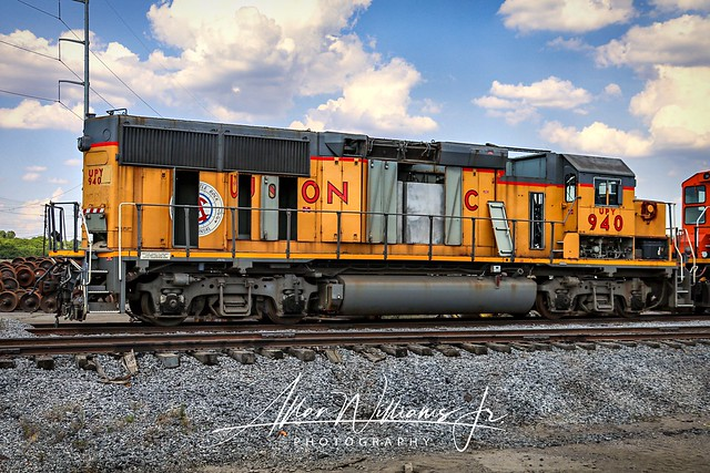 Union Pacific Yard 940 awaits the torch at Progress Rail in Memphis. UPY 940 is the North Little Rock Centennial locomotive and has it still on the end of the hood but hard to see due to doors being open.