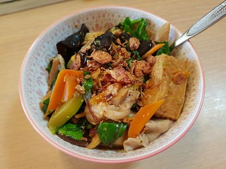 Leftover Chinese Tofu and Veggies on baked potato with fried shallots