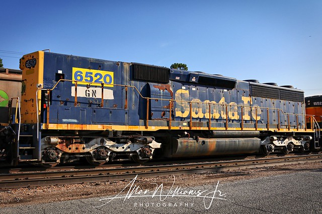 Former Santa Fe SD45-2B, now GN lettered seen waiting and heading to the scrapper on the island in Memphis.