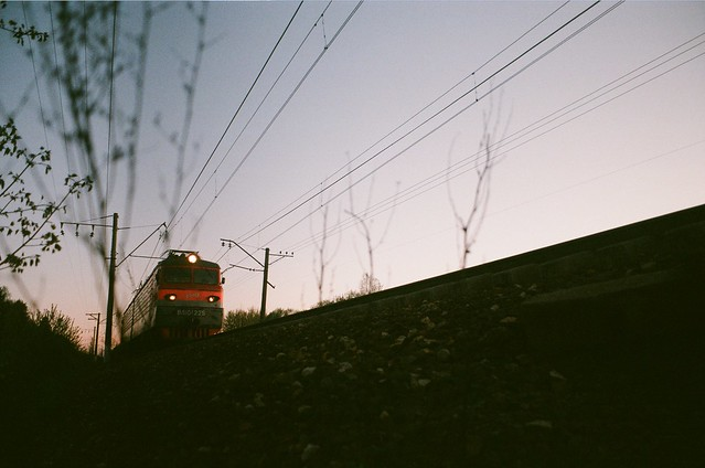 The train is rushing through the sunset